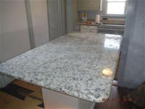 ashen white granite kitchen countertop install for the