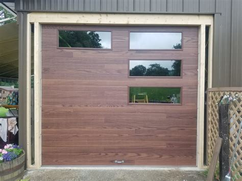 chion garage doors chi door c h i 3216p woodtones plank door in oak