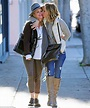 Maria Bello and girlfriend pack on the PDA while holiday ...