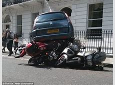 People carrier pictured parked ON TOP of four motorbikes