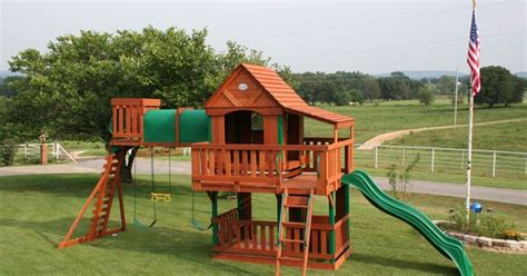 treasure trove swing set  wood roof canopy cedar