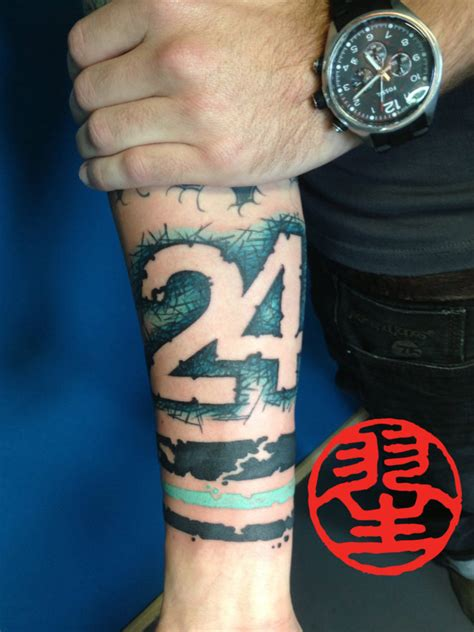 number 27 graphical typography forearm