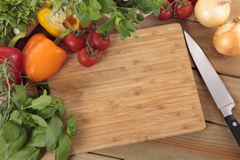 Herbs and vegetables with a chopping board Photo   Free