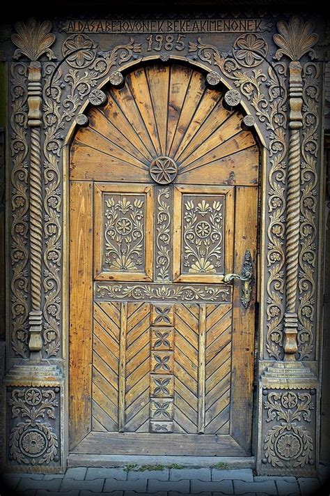 splendidly intricate hand carved doors