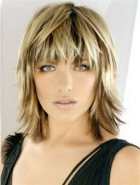 medium length choppy shag haircut with wispy bangs and dark haircuts pinterest