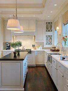 white cabinets dark countertops dark floors