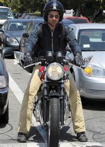 casual motorcycle riding motorcycle man bradley cooper shows macho side by riding