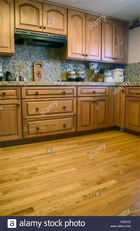 kitchen with oak cabinets wood floor and granite