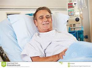 Portrait Of Male Patient Relaxing In Hospital Bed Stock ...