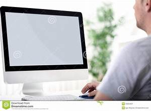 Young Man Working On Computer Stock Image - Image: 33254007