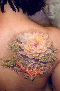 Lovely koi fish and lotus tattoo on shoulder blade ...