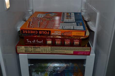Frozen pizza box in side by side fridge