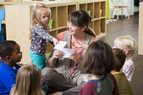 special needs child in preschool class with 382 | istock 000064309969 small child with special needs in classroom