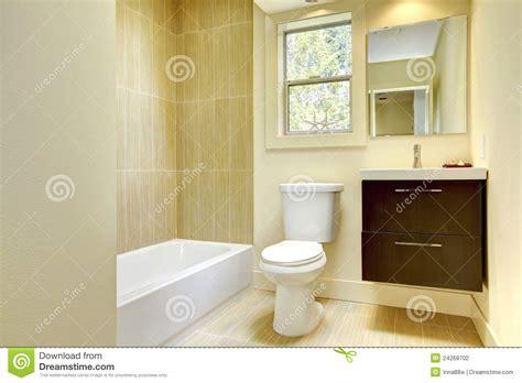 new modern yellow bathroom with beige tiles stock
