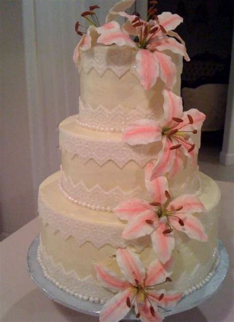 Three Tier Butter Cream Wedding Cake With White And Pink