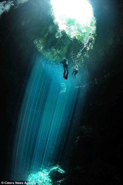 scuba diver photographs  ancient mayan sinkhole