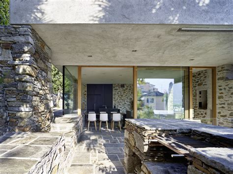 modern stone house  terraced garden overlooking lake