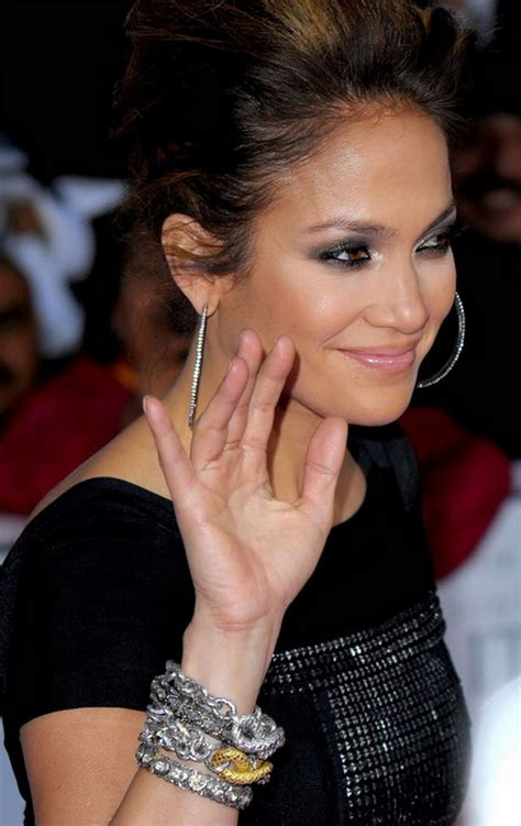 jennifer lopez black hoops bold bracelets gem obsessed