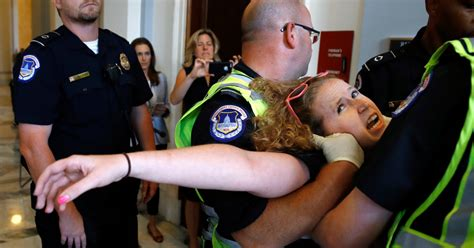 police remove disabled protesters  mitch mcconnell