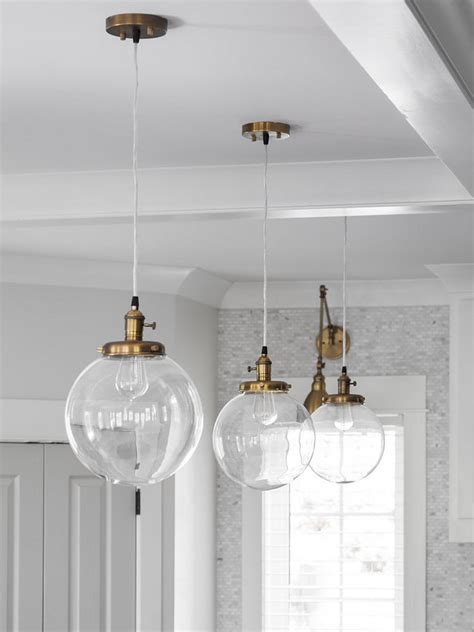 brass globe pendant light interior design ideas home bunch interior design ideas