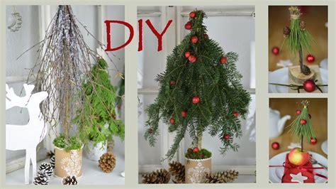 diy weihnachtsdeko selber machen baeume aus zweigen und
