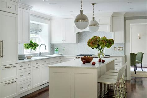 white l shaped kitchen with island white kitchen with polished nickel hicks pendants