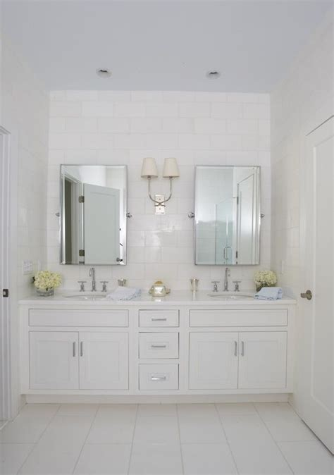Two Mirrors In Bathroom by White On White Single Sconce In Between Two Mirrors