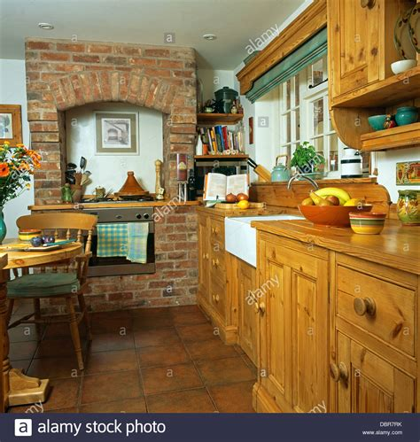 Brick Kitchen Cupboards by Pine Fitted Cupboards In Country Kitchen With Oven In