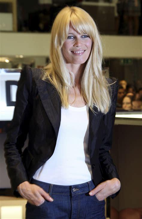 claudia schiffer turns supermodel hand  clothing