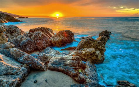 sunset rocks sea beach background hd