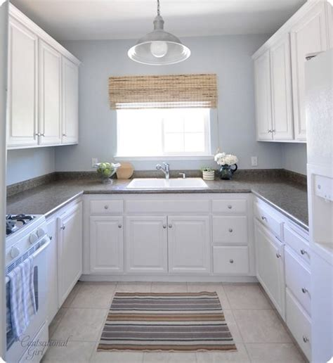 white kitchen cabinet makeover oak cabinet makeover before picture of the cabinets look 1343