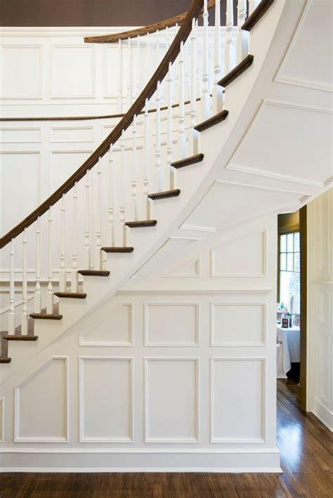 stairs curved staircase staircases  wood paneling