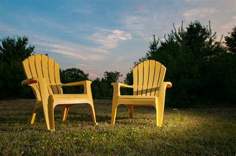 yellow plastic lawn chairs by frozen canuck 500px