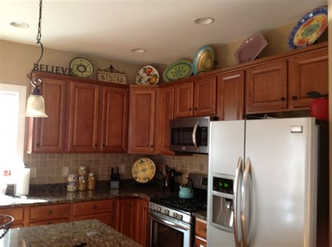 top of kitchen cabinet ideas 19 best images about kitchen top of cabinets on