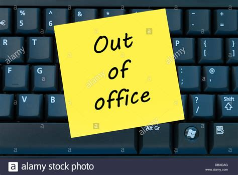 bureau post it out of office post it sticky yellow note stock photo