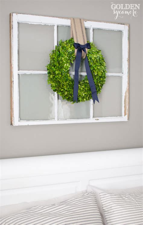 Christmas Boxwood Wreath hang on large white rectangular mirror in foyer instead of a window