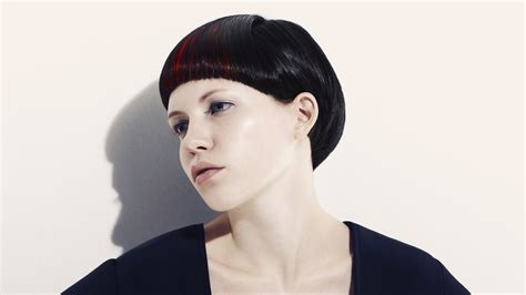 short  bowl style haircut black hair  red strands