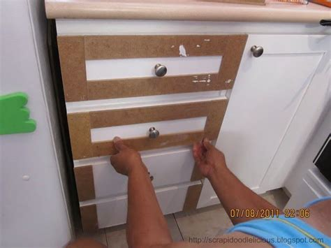 adding trim to plain cabinets diy shaker molding added to plain doors shaker style