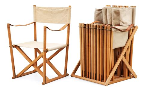 a set of six folding chairs with stand by mogens koch