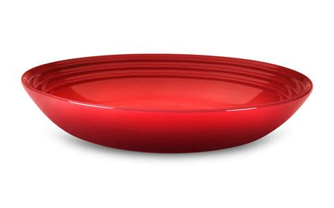 le creuset stoneware pasta bowl  cherry red cutlery