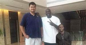 This pic of Kevin Hart standing next to Shaq & Yao Ming ...
