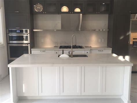 Calacatta nuvo caesarstone kitchen, island and backsplash