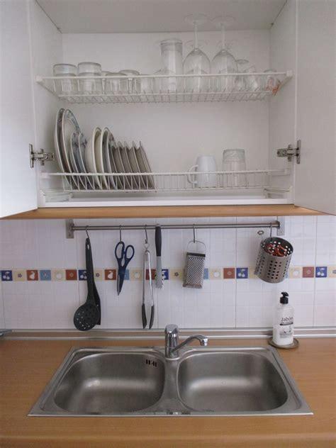 spanish favorites dish drain cupboard kitchen sink design kitchen design interior design