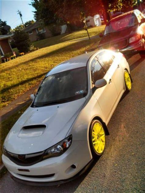 sell   white subaru impreza neon wheels lowered
