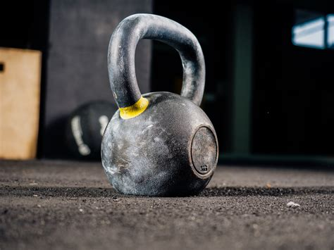 kettlebell swings kettlebells muscles swing lower