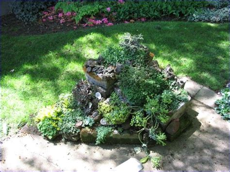 small rock garden planted with sedum garden landscape