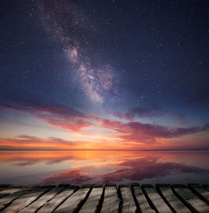 twilight starry sky  ocean horizon stock photo