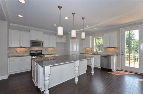 open kitchen with granite countertops and large island