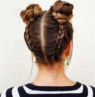 Dutch Braids with Buns Hairstyle