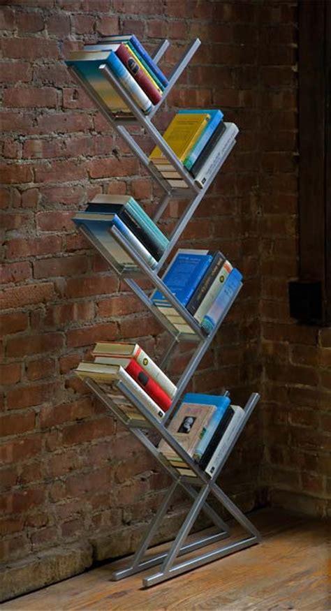 minimalist steel bookcases  corian  bamboo shelves